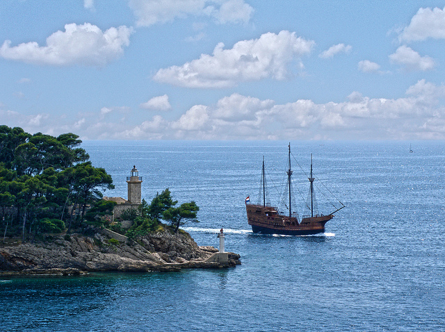 Lighthouse on the haunted island of Daksa guides a passing pirate ship (credit: Greg Weeks/flickr)