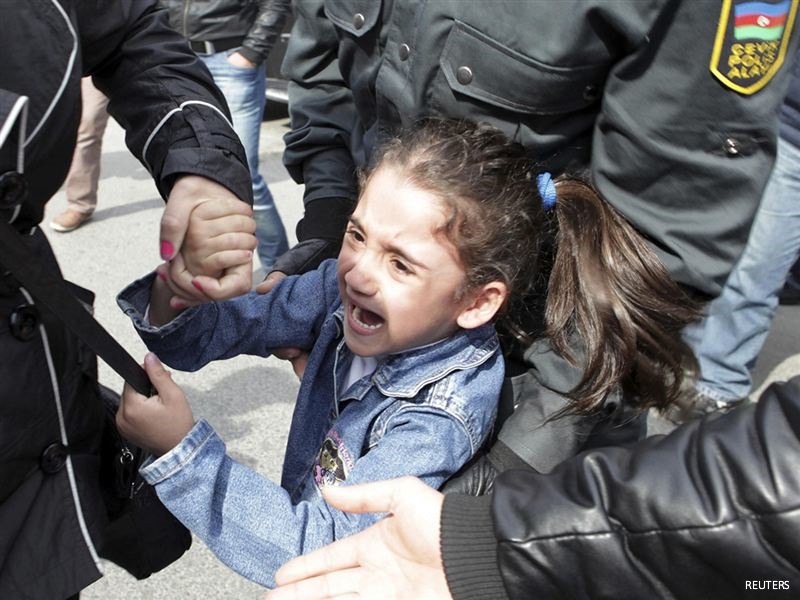 """Azeri girl, 6, arrested at protest for shouting """"freedom"""""""
