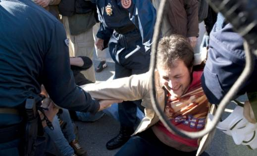Police remove a protester who'd been sitting blocking traffic in Podgorica, Montenegro earlier today. (Photo credit: Luka Zekovic/Vijesti.me)