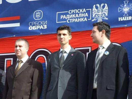 Serbian Radical party members with Obraz leader Mladen Obradovic. The Obraz logo is on campaign materials though the organization has been banned by the Constitutional Court.