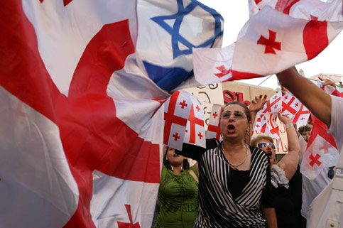 Georgian protesters with Israeli flags.