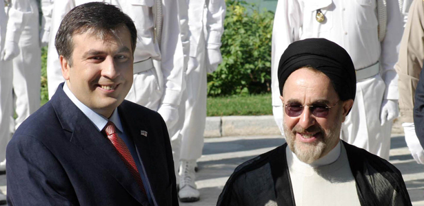 The former Georgian President Mikhail Saakashvili, left, shakes hand with his then-counterpart from Iran, Mohammad Khatami, in 2004. (Photo credit: AP)