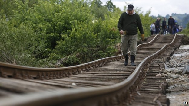 A man walks on the tracks near Tuzla, Bosnia (AP)