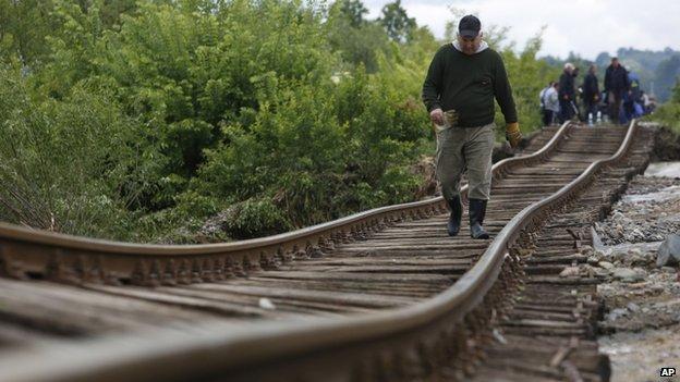 A man walks on the tracks near Tuzla, Bosnia (AP)