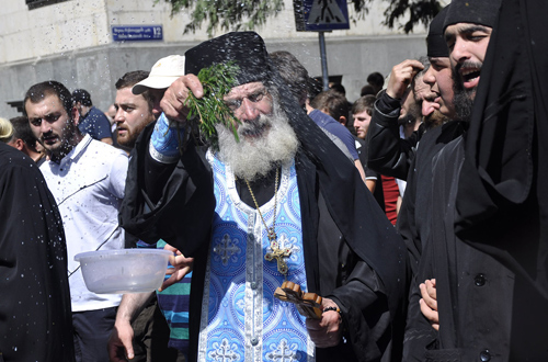 Priest blesses the pro-family rally, May 17, 2014 (Photo credit: Eana Korbezashvili/Civil.ge)