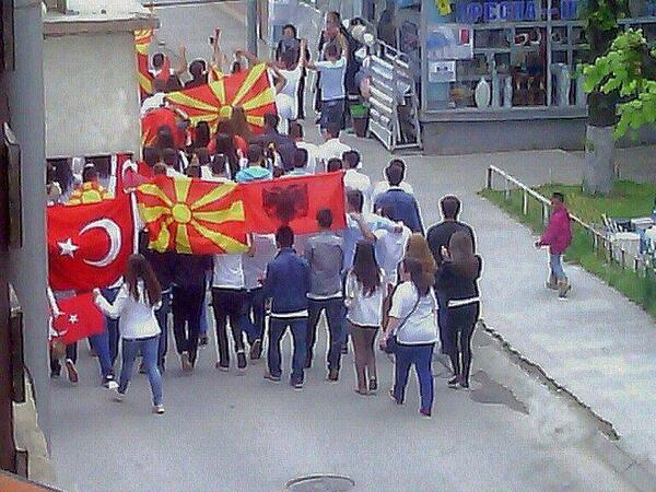 """""""After the ethnic riots in Skopje, Albanian, Turkish and Macedonian youngsters in the town of Resen march for peace"""" (Photo credit: Tanja Milevska/Twitter)"""