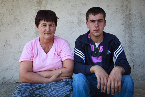 Razija Alji, 54, with her only living son Ruzmir, 19. After returning to their pre-war home in the village of Lukavica Rijeka, the family suffered a series of tragedies: In 1996, Razija Razija lost Nedzad, 19, in a landmine incident near their home. Just two years later, her husband was killed in a separate explosion. In summer 2011, Razija's second son Yusuf and his brother-in-law were fatally wounded when a landmine detonated, and died in the forests.