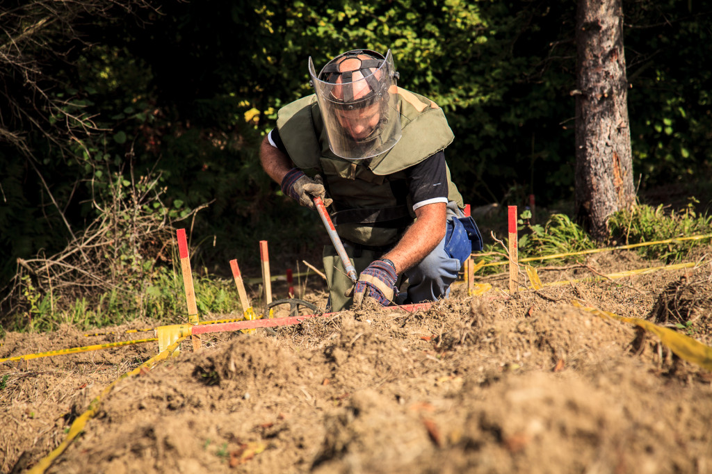 Goran Stanusic from Bosnia and Herzegovina Mine Action Center (BHMAC) clears a lot in an area near Visoko. Members of the mine squad work alone and scan about five square meters with a metal detector every 30 minutes.