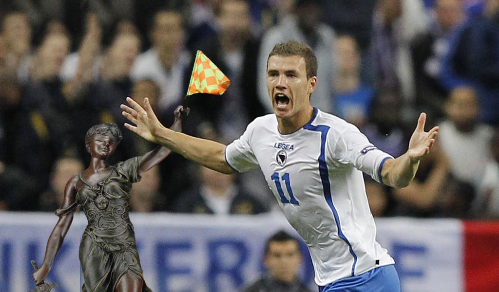 Bosnia's forward Edin Dzeko celebrates a