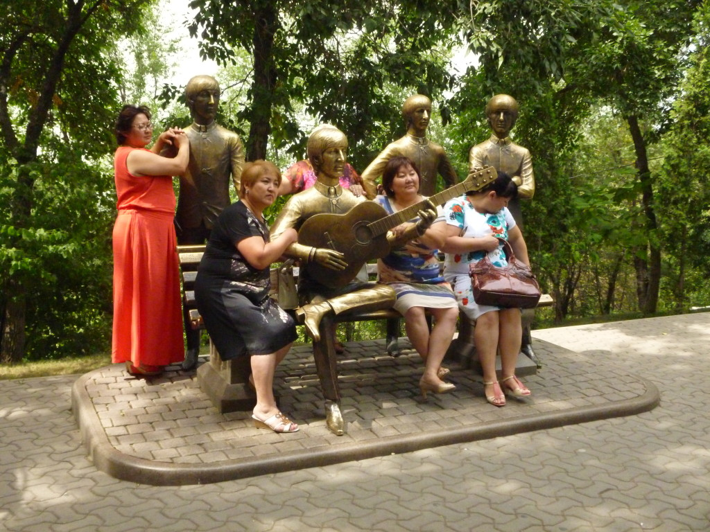 A group of Kazakhstani women have their picture taken at the Beatles monument in Kok Tebe, Almaty.
