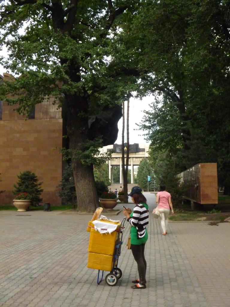 Ice cream seller in Panfilov Park—so named for the monument to Panfilov's men seen here in the background of the photograph.