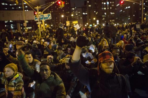 Protesters take part in a demonstration demanding justice for the death of Eric Garner in Manhattan, New York City