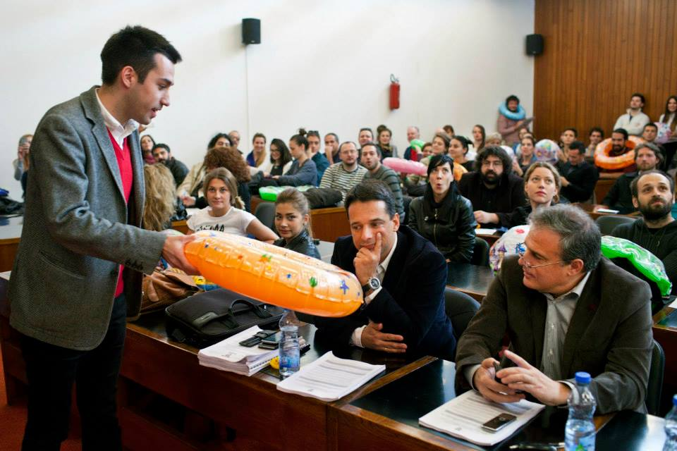 Dobrica Veselinović of Ne da(vi)mo Beograd hands out inflatable swimming rings at a public session held at the Belgrade City Assembly in November 2014 (Photo credit: Ne da(vi)mo Beograd's Facebook page).