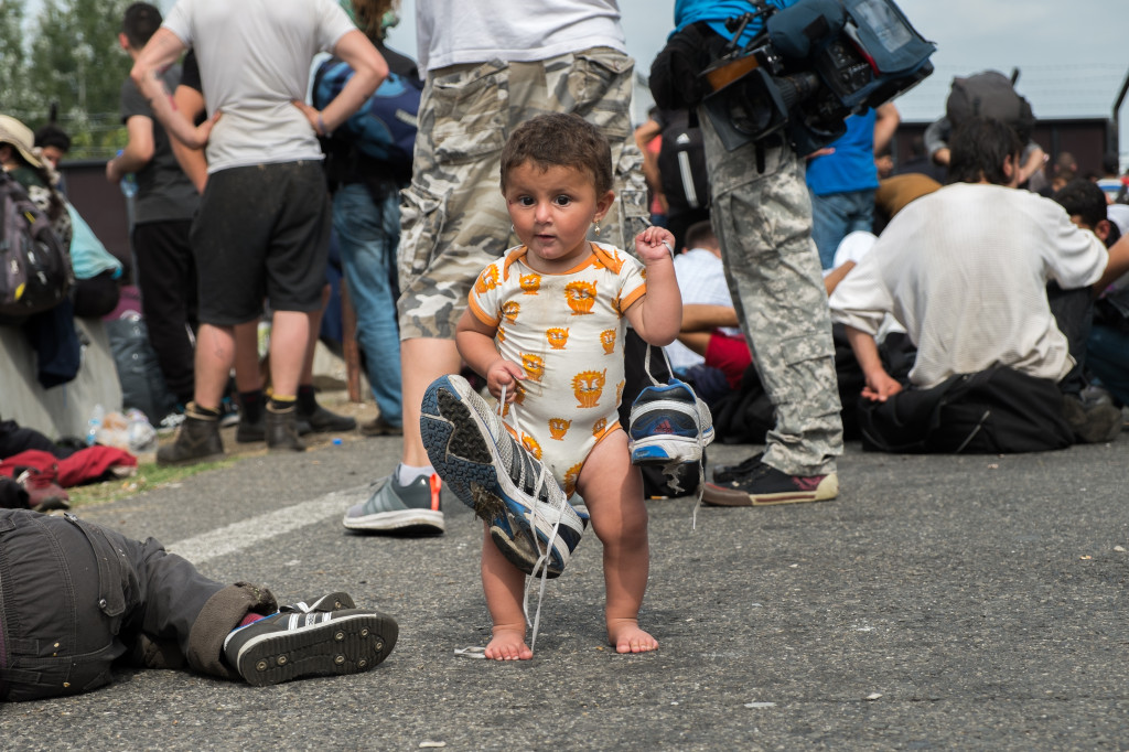 Horgoš on Tuesday. Bisal from Syria, 9 months, learning to walk at the Hungarian border. Photo by author.
