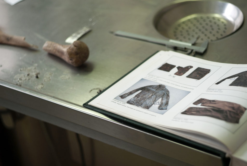 Clothing found in mass graves is meticulously documented to use as further reference for victim ID's. (Photo credit: Chris Bobyn)